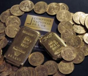 Qu'est-ce que la prime d'une pièce d'or et comment est-elle fixée?